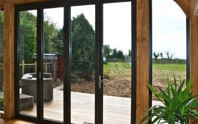 Aluminium Bifolding Doors in oak Timber Frame